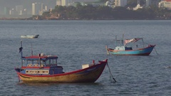 Vietnamese boats in a sea at sunrise. Vietnam travel landscape and destinations. Stock Footage