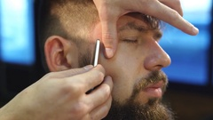 Men's hairstyling, haircutting, in a barber shop or hair salon Stock Footage