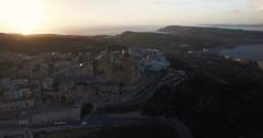 Aerial shot around a church during dusk Stock Footage