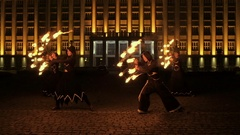 Female fire show performer at night. Poi performance. Caucasian girl with fire Stock Footage