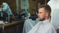 Looking good. Side view of handsome young bearded man looking at his reflection Stock Footage