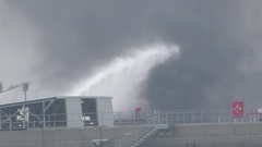 Firefighter water jet extinguish the fire started near a petrol storage tank Stock Footage