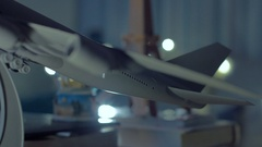 Stock video footage. Toy aircraft with globe and Eiffel Tower on the table Stock Footage
