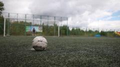 Children's football. Closeup kick a soccer ball. Stock Footage