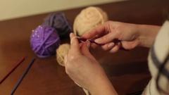 Woman knits crochet beige wool threads. Stock Footage