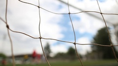 Football. Penalty. Children's football. Close-up of a grid of football gate. Stock Footage