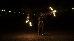 Fire show performance. Handsome male fire juggler performing contact Stock Footage