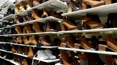 Empty big modern shop with many pairs of shoes on shelves Stock Footage