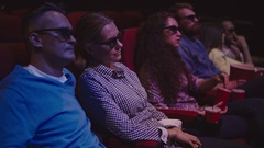 Watching Movie in 3D Glasses Stock Footage