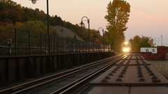 Train moving down tracks- lights on beautiful background Stock Footage