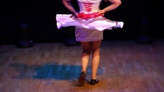 Legs of a young girl in Russian traditional dress dancing on stage Stock Footage
