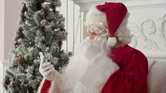 Laughing Santa Claus reading Christmas messages from kids Stock Footage