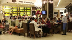 People sit at cafe in Siam Paragon Mall. Bangkok, Thailand Stock Footage
