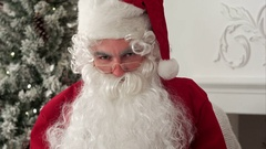 Santa Claus posing for photo and realising he is being filmed Stock Footage
