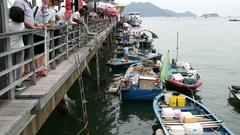 People at pier buying fish Sai Kung Hong Kong Stock Footage