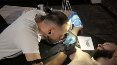 Getting a tattoo. Close-up, toned image Stock Footage