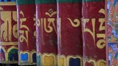 Buddhist prayer wheels in monastery with written mantra. India, Himalaya, Ladakh Stock Footage