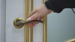Hand opening the white door Stock Footage