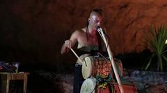 Illusionist Kristian Jyoti plays the drums . Koh Phangan, Thailand Stock Footage