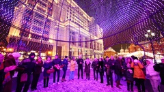 People stand in a Christmas ball on Manezhnaya Square Stock Footage