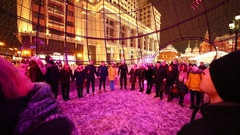 People are holding hands in a Christmas ball on Manezhnaya Square Stock Footage