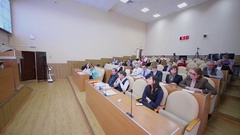Panorama of auditorium with people watch presentation during IT-seminar Stock Footage