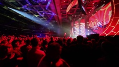 Lot of spectators watch performance and video art on stage Stock Footage