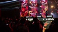 Photographers shoot performance of musicians on stage Stock Footage