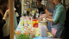 People work at market on territory of fresh vegetables eaters festival Stock Footage