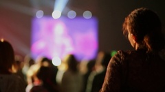 Woman dance near crowd of spectators during concert Stock Footage