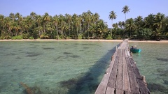Wooden pier on the tropical beach with coconut palm tree on the sea, Thailand Stock Footage