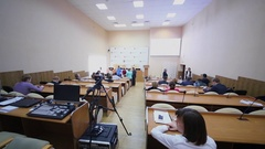 People sit in auditorium before IT-seminar hold by department of education Stock Footage