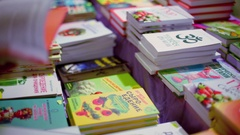 Many books about vegetarians and yoga on market table Stock Footage