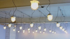 Many retro lamp hang on wires at ceiling in Moscow Stock Footage