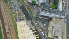 Trucks and DHL company building with yellow roof near railway Stock Footage