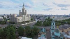 Traffic near edifice of Trinity church and skyscraper on Kotelnicheskaya quay Stock Footage