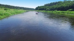 Tvertsa river with people scull on canoes at summer day. Aerial view Stock Footage