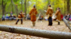 Animators in native suits performs for tourists at autumn day Stock Footage