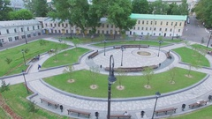 Hitrovskaya square with benches and lampposts at summer day. Aerial view Stock Footage