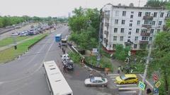 Town traffic Ivanteevskaya street and city service remove fallen trees Stock Footage