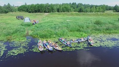 Several boats with people before river traveling at sunny summer day Stock Footage