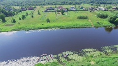 People on canoes start journey by Tvertsa river not far from village Arkistovideo