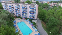 Tourists swim in pool of Les Agapanthes de LEsterel 3 stars inter-hotel Stock Footage