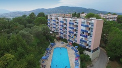 Tourists get res in pool of 3 stars inter-hotel Les Agapanthes de Lesterel Stock Footage
