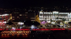 Boulevard Croisette with traffic near hotels Marriott and InterContinental Stock Footage