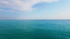 Clouds above azure sea with vessels on horizon at summer day. Aerial view Stock Footage