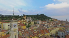 Urban sector with St. Francis tower among houses at summer day. Aerial view Stock Footage