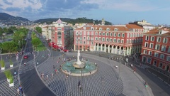 Townscape with people walk by Massena square near Fountain of Sun Stock Footage