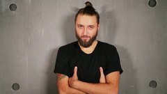 Man with beard poses near wall during photo session Stock Footage