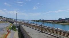 Railway near Tourist landing Marina Castelluccio and port Voltri Terminal Europa Stock Footage